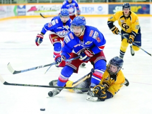 Brett Mennear of the Prince George Spruce Kings tries to put a shot on net before being hauled down by Tyrell Boucher of the Grande Prairie Storm on Friday at Rolling Mix Concrete Arena. The Storm took on the Spruce Kings in a BCHL/AJHL exhibition match-up. Citizen Photo by James Doyle      September 2, 2016